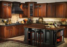 I like the contrast of brown and black cabinets.