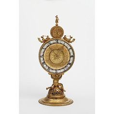 This clock was made in 1564 by a famous German clockmaker, Jeremias Metzger (or Metzker), of Augsburg.    This form of clock with a vertical, circular dial on a footed base is known as a 'monstrance' or 'mirror' clock for its similarity in shape. Such clocks were popular in Europe between 1580 and 1630. Their cases were usually of cast and chased bronze or of cast and beaten copper and brass sheet. The cases were commonly gilded (coated with a fine layer of gold). The movements are similar…