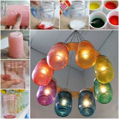 If you love repurposing Mason Jars, these Hanging Lanterns are just the ticket! Learn how to dye Mason Jars and make a Mason Jar Chandelier as well. Be sure to watch the video tutorial too. You'll love these ideas. Mason Jar Chandelier, Mason Jar Lanterns, Hanging Mason Jars, Mason Jar Lighting, Tinted Mason Jars, Colored Mason Jars, Mason Jar Diy, Mason Jar Lamp, Glitter Jars