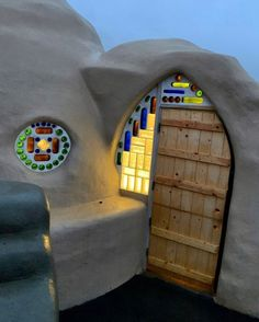 """Cal-Earth Institute on Instagram: """"Lights in the desert! Stained glass and SuperAdobe dreams do come true with @jamielynnrabb. #superadobe #desertdome"""" Earth Bag House, Earth Dome, Green Magic Homes, Dome Homes, Desert Homes, Dreams Do Come True, Land Of Enchantment, Natural Building, Earthship"""
