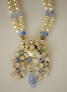 Dramatic Miriam Haskell Faux Pearl and Glass Necklace, ca. 1955, composed of a double strand of baroque faux pearls and twisted blue glass beads