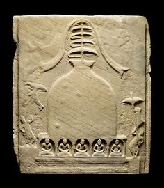 6th C. Sandstone Slab depicts a buddhist Stupa (shrine) and relic or monks graves. A tall cylindrical stupa of this type is still preserved in the ancient Pyu city of Sri Ksetra. This slab covered the Khin Ba Stupa brick-lined relic chamber in central Myanmar. Thiri Khittaya (Śrī Ksetra) Archaeological Museum, Myanmar.