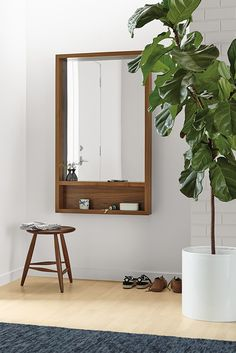 Add a modern mirror with storage to your entryway.