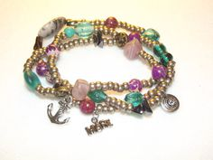 """This Wrap showcases Pewter Seed Beads, along with Imperial Jasper and Glass Accent beads. Adorned with Pewter Anchor, Alloy """"Hope"""" and a Pewter Round Drop Charm."""