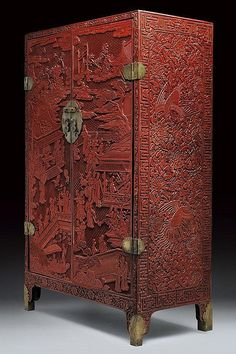 A rare and important red lacquered cabinet. 16th Century Ming Dynasty.