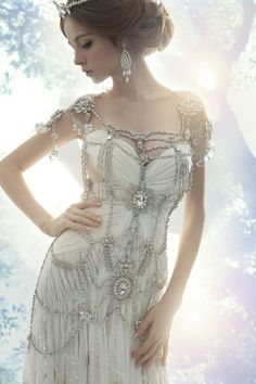 Incredible jeweled wedding dress - 12 Steampunk Wedding Dresses - the dress looks simple, yet the jewels and beading give it more piazza Mode Steampunk, Steampunk Fashion, Steampunk Outfits, Steampunk Clock, Steampunk Corset, Victorian Steampunk, Gothic Fashion, Crystal Wedding Dresses, Wedding Gowns