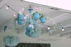 A partir d'une structure de lustre chandelier et de pots de fleurs, créez un très joli pot suspendu pour vos plantations. Au jardin ou même à l'intérieur, http://www.flemarie.fr/blog/2014/04/diy-fabriquer-un-lustre-chandelier-pots-de-fleurs/