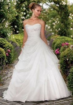 Essense of Australia. Gown features asymmetric-beaded bodice, side pick-up, and lace or zip-up option.