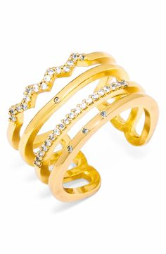 This bold 14-karat gold-plated ring makes a modern statement with layers of precisely placed pavé crystals.