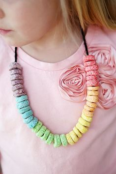 Rainbow cereal necklaces...another idea--have kids paint $1 raw wood picture frames from the craft store and glue rainbow cereal onto it to create a flat circle pattern, then print photos of the party guests with the birthday kid to send out with thank you notes