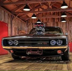 Amazing black Dodge Charger inside of a seriously cool wooden floored shop