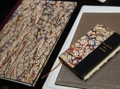 """bookbindings by Legatoria Artigiana for Museo Filangieri in Napoli, marbled papers """"tiger eyes"""" by the marbler Flavio Aquilina."""