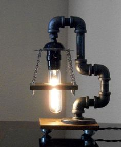 Industrial Art Black Pipe Table Desk Lamp with Reclaimed Wood. $140.00, via Etsy.