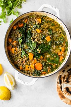 Make a big pot of this healthy, vegetarian (and vegan) Lebanese Lentil Soup, made with green lentils, kale, sweet potato, ginger and lots of garlic and lemon. #lentilsoup #lentils #pantryrecipes