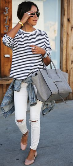 Just The Design: Julie Sarinana is wearing a striped T-shirt from Gap, white skinny jeans from TopShop, pink flat shoes from Chloe, denim jacket from J. Crew and the sunglasses are from Saint Laurent