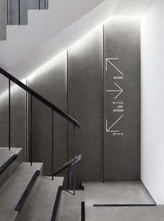 Image 3 of 29 from gallery of CJ azit / Betwin Space Design. Photograph by Yong-joon Choi Bg Design, Signage Design, Wall Design, Lift Design, Interior Staircase, Staircase Design, Office Signage, Wayfinding Signs, Sign Board Design