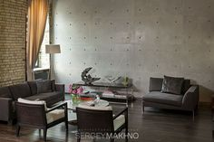 exposed concrete and brick walls living room - Podil Loft Apartment