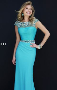 Achieve luxury and sophistication in Sherri Hill 32026. This lovely evening gown features a sheer bateau neckline with fitted bodice. The unique beaded belt defines the bodice with waistband that will give you a flattering figure. The full length skirt will give you an elegant look.