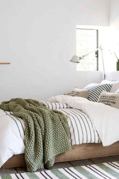 Love the nautical/seaside inspired colour scheme! For low wooden beds and stripey bedding try: www.naturalbedcompany.co.uk