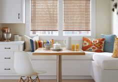 Metal makes its mark (™) in this contemporary casual white kitchen.  Hunter Douglas Modern Precious Metals® aluminum blinds are now available with the UltraGlide® operating system designed to enhance safety and simplicity in a home.  #WindowTreatments