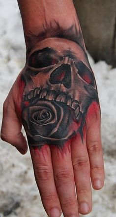 Skull and rose hand tattoo