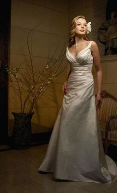 Casablanca 1831: buy this dress for a fraction of the salon price on PreOwnedWeddingDresses.com