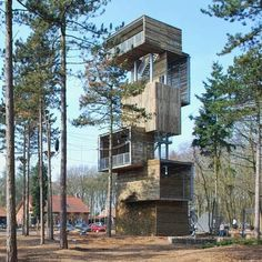 Dutch architects Ateliereen Architecten have completed a 25 metre tall viewing tower at an outdoor sports park in Reusel, the Netherlands. The structure comprises six boxes resting on a steel, structural core and incorporates abseiling and climbing facilities. The walls of the tower are made of halved logs, grown in the surrounding forest, which are