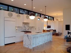 adore this kitchen - the clerestory windows, the white cabinets, the marble, the lighting, the floors