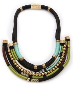 HOLST + LEE, $204.00 from $510.00 Multicolor Forest Through The Trees Necklace Vibrant thread wraps the cords of an eye-catching Holst + Lee necklace. Metal beads accent the tiered bib, balancing the weighty magnetic clasp. Made in the USA.