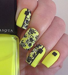 Floral inspired yellow nail art design. Black and yellow has always been a perfect combination. White is also added occasionally to add more depth into the design. In this design you can see intricate details of flowers painted in black as well as simple striped divide design to make it look even more special.