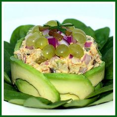 2 avocados  1/4 c grapes, halved  handful of chives, chopped  1 can tuna  6 sweet gherkins or other pickle, diced  3 tbsp mayo or salad dressing  1/2 red onion, diced  2 cups spinach leaves, washed and dried  1 celery stalk, chopped  dash of pepper and garlic powder