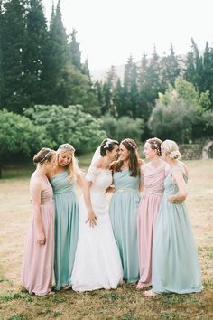 Bridesmaids wear pale pink and green dresses from H & M | Photography by http://www.mandjphotos.com/