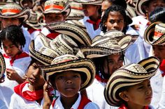 Colombian children, wearing a traditional Caribbean clothes and the Vueltiao hats