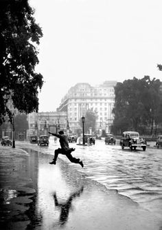 Jumping the puddle. Hyde Park, London. 1939. Photographer: J.A. Hampton