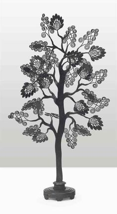 EDGAR BRANDT (1880-1960) A FABRIC DISPLAY TREE, CIRCA 1925 patinated wrought-iron 49 in. (124.5 cm.) high, 28 in. (71.2 cm.) wide