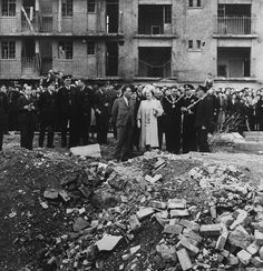 King George VI and Queen Elizabeth visit the site of the last V2 to fall on London on Mar 27, 1945 at Vallance Road, Stepney, in the East End, London and 134 people were killed, mostly Jewish refugees, Oct 4, 1945 (UK National Archives)