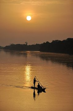Africa, View at dusk from a Congo river barge near Kisangani, © Peter Gostelow