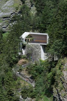 New Visitors Center in the Viamala Gorge by Iseppi-Kurath l his gabled concrete visitor is perched on the edge of a 60-metre gorge in the Swiss Alps (+ slideshow).