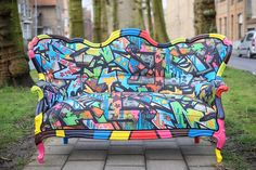 Graffiti chair upholsterd in fabric designed by Select Style on Etsy, $3,071.34