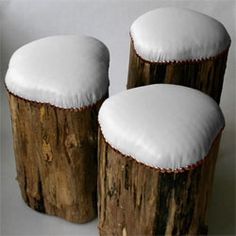 Reminiscent of snow-covered stumps, wood for these stools were harvested from a fallen maple tree. White leather upholstery  and copper tacks over organic latex foam. Small, nearly-invisible feet 'levitate' them ever off the ground.