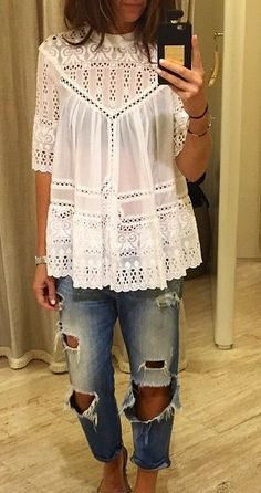 Cute outfit, white blouse and trashed jeans!