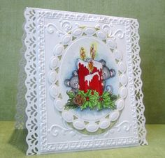 Christmas card with lacey white layers of die cuts, edge punching and embossing...cute image of candle and mice...