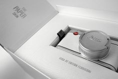 """The Leica Edition """"Fedrigoni"""" has been produced as a limited series of 25 cameras. It is the first Leica camera clad in a """"paper skin"""" and wrapped in 15 quality designer papers. The shimmering, pearlescent Fedrigoni paper """"Constellation Jade"""" replace… Cool Packaging, Brand Packaging, Packaging Ideas, Design Packaging, Gift Packaging, Paper Camera, Electronic Packaging, Paper Manufacturers, Clever Gadgets"""