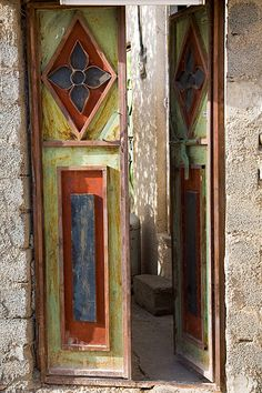 Door in a village in Jebel Akhdar, Oman This would make great fence or yard art to add color