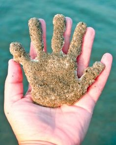 Sandy Handprint Keepsake....  take  plaster of paris in a large ziploc to the beach and mix in some sea water