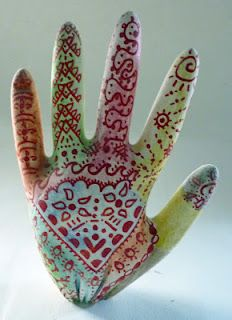 Plaster of Paris hands painted with water colours and decorated with Sharpies.