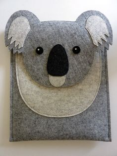 *** This koala case fits the iPad Pro 12.9 and 9.7 inch. ***  It is made with high quality wool felt. The flap is attached with a metal button. Details are made with wool felt. The sparkles in the eyes are added by Swarovski rhinestones. There is a useful pocket at the front of the case to carry your small accessories. The case is lined with black poly-cotton.  Design wool felt is an eco-friendly, sustainable and renewable material and it is perfect to protect your iPad since it is shock…