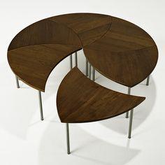 "PETER HVIDT  FRANCE AND SONS  Segmented coffee table (no. 523), Denmark, 1960s  Teak, matte chromed steel  Manufacturer label  17"" x 51"" dia."