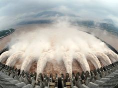 Holding Back the Deluge: Water being discharged from the Three Gorges Dam at Yichang, Hubei province where heavy rains have pushed waters to the highest levels in a decade.