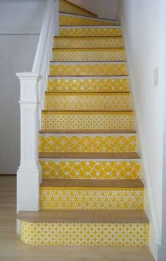 Staircase idea maybe instead of paint...mod podge a scrap paper. Not yellow... Maybe silver & white